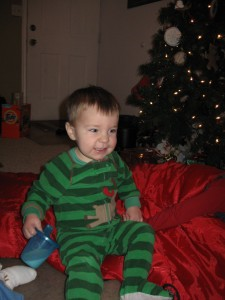 Love the cheesy grin and the Christmas pj's!
